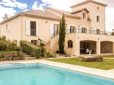 Photo for Spacious luxury villa with private heated pool and sauna at an golf course.