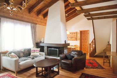 top two floors with lots of wood and a fireplace and balcony