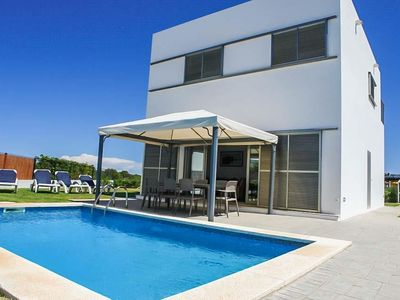 Photo for 4 bedroom Villa, sleeps 8 in Cala en Bosch with Pool, Air Con and WiFi