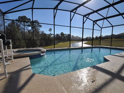 Screened pool with lake view