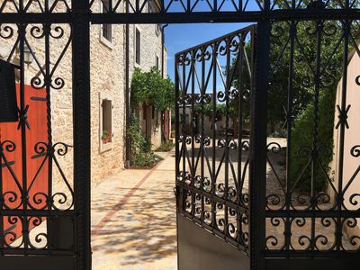 Photo for Stunning and spacious restored stone house with pool, olive grove,  sea views.