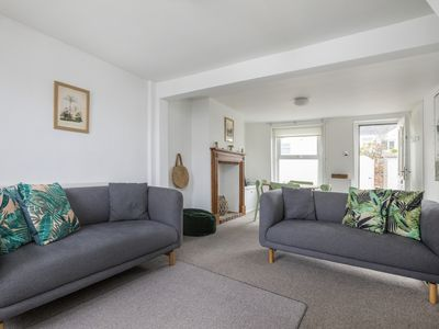 Photo for Just one row back from the beach; sea view; family & dog friendly