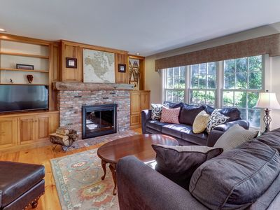 Photo for Beautiful home w/ a shared pool overlooking a garden & pond - walk to stores
