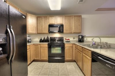 Upgraded appliaces with side by side fridge and ice maker.