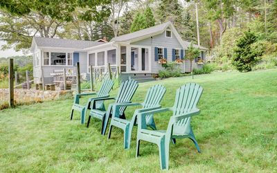 Yard - Watch the sun rise or set over the water from the yard, furnished with several Adirondack chairs.