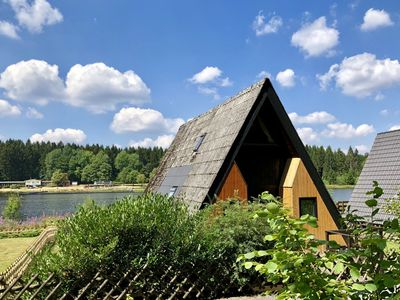 Photo for Wooden chalet with oven, in Oberharz near a lake
