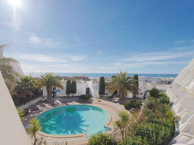 Photo for At sunset, swimming pool, sea view, and direct beach access!