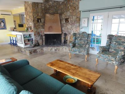 Living room with French doors to veranda. Open plan to kitchen & dining areas.