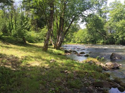 Photo for Cozy Cottage With River View! Fish year around or bike on Alpine Trail