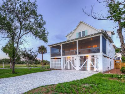 Photo for 🎉🎉 April & May special pricing🎉🎉 Optional heated pool- screened porch-marsh view