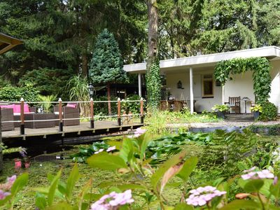 Photo for A detached bungalow with outdoor fireplace, covered terrace and pond in a forest plot