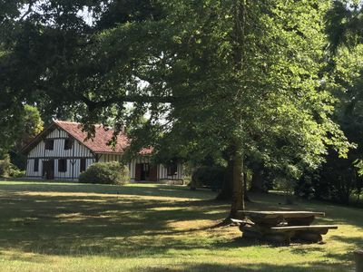 Photo for Traditional French farmhouse, beautifully renovated with a pool in the forest