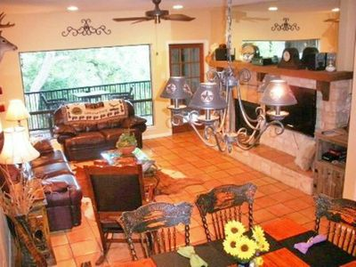 living room has a large picture window that overlooks the Comal