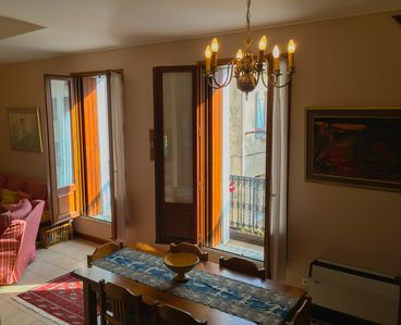 Living & Dining area with french windows & balcony