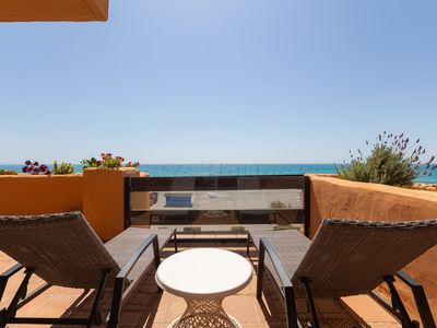 Photo for Frontline beach 2 bedroom apartment in Los Granados with panoramic sea views, pool, gardens, Wi-Fi