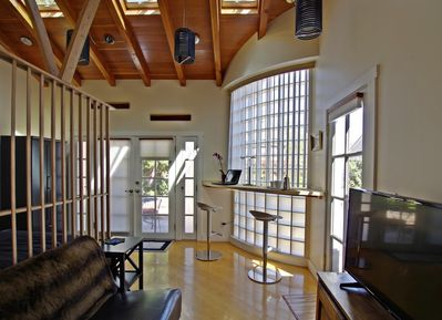 Studio with natural light from all sides and skylights in the vaulted ceiling.