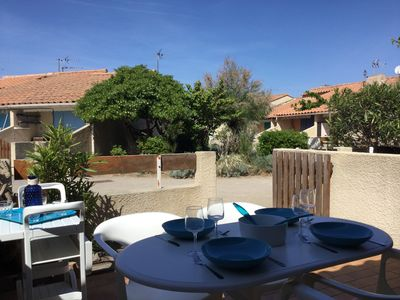 Photo for Very pretty small house in gated, 150 meters from the beach !!
