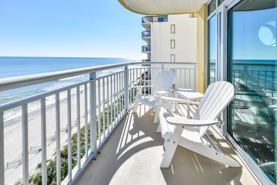 Large sunny ocean front balcony with comfy chairs to relax for hours!