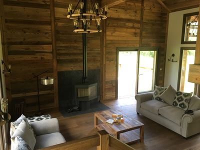 double height lounge with wood burning stove and seating for all