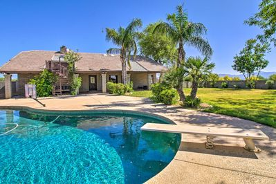The vacation rental boasts a gorgeous pool area and expansive grounds.