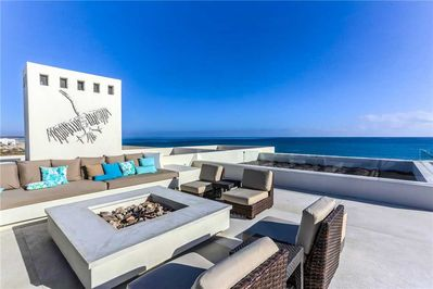 Relax on a beautiful rooftop with fire pit and comfortable seating