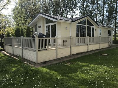 Photo for Lakeside Lodge With Hot Tub  We do not accept bookings of only 1 night