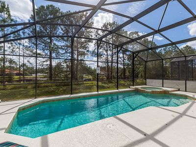 Photo for Executive pool/spa home on an exclusive gated community,  20 min from The Mouse