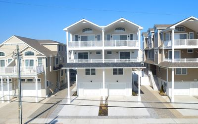 Photo for 55 inch Smart TV with game table and an extra fridge. Large covered deck has a view of the ocean.