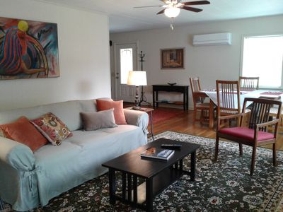 Living/Dining Room has a tv.  Room opens to a large sundeck.
