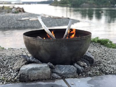 Steel fire pit by the edge of the sea wall 🔥