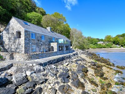 Photo for Fully refurbished for 2019 and located on the water's edge of the picturesque Llanbedrog beach with