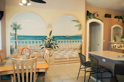 Dining room with Wall Mural. Open Floor Plan