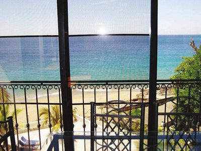 Photo for Sea-views central condo on sandy beach, guest-friendly, pool, WiFi, cable TV