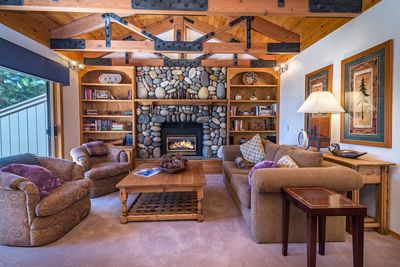 Living Room - The cozy cabin-style living room invites you to snuggle up with a book.