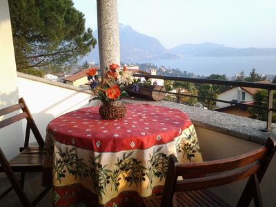 Photo for Intimate apartment with terrace overlooking the lake, garden and air conditioning