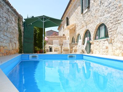 Photo for This 4-bedroom villa for up to 12 guests is located in Porec and has a private swimming pool and Wi-