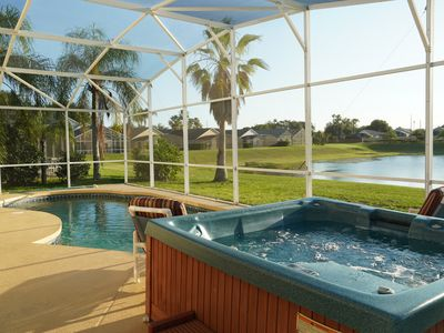 Photo for Disney 5 minutes - 2 Master King, Pool, Hot Tub, Games, Deck Overlooking Lake!