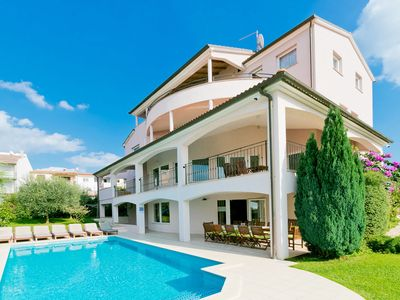 Photo for This 8-bedroom villa for up to 16 guests is located in Porec and has a private swimming pool, air-co