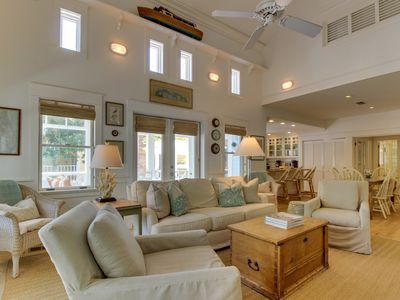 Photo for High-end cottage w/ wraparound decks, a shared pool, walk to the beach!