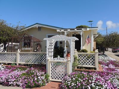 Photo for Charming & Historic Beach Cottage - Oasis in the Heart of Downtown