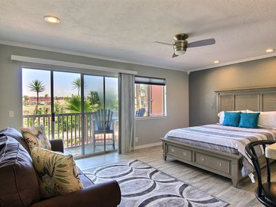 Photo for Modern poolside condo with shared pool and fishing docks!