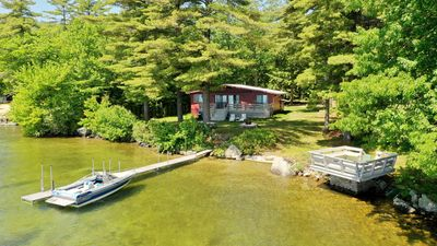 Prime, private waterfront property on Winnipesaukee w/ ample docking and parking