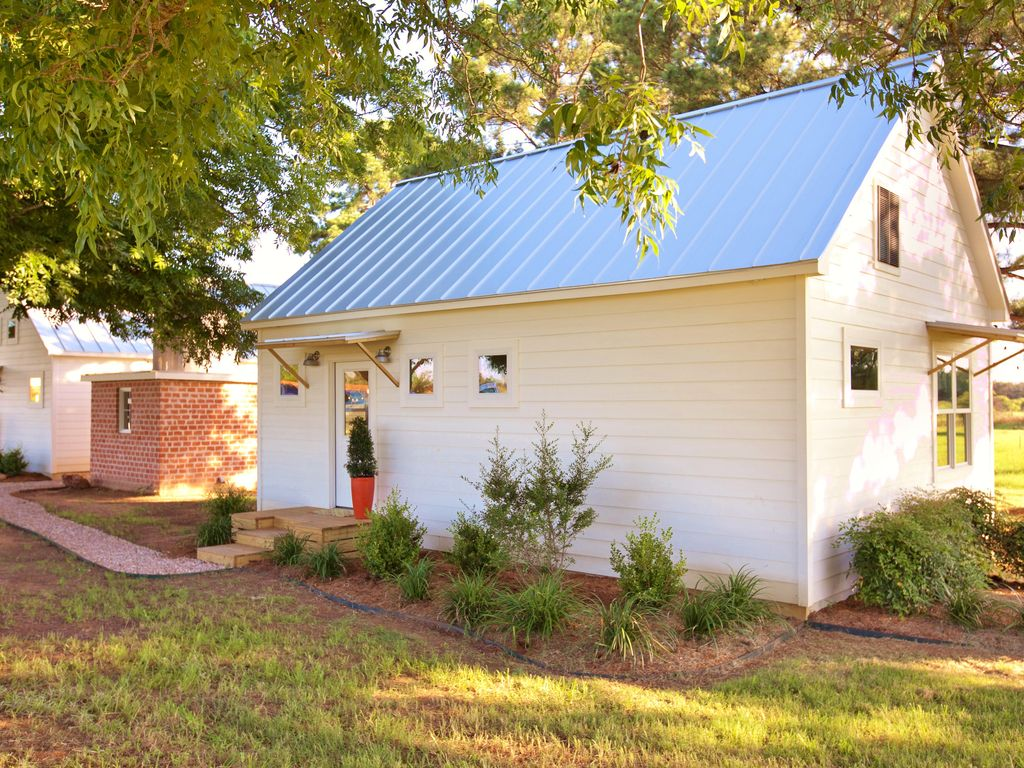 cottage tx gallery us plum fredericksburg cottages com this hotel booking image lodge cabin property of