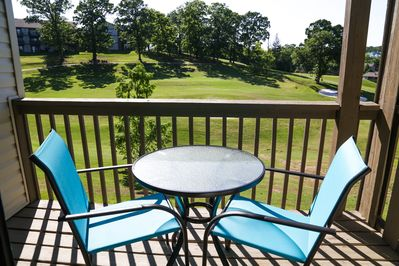 Cozy balcony porch with incredible views of the golf course.
