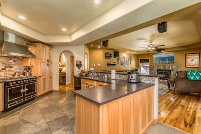Kitchen - The kitchen features granite counters and a large island