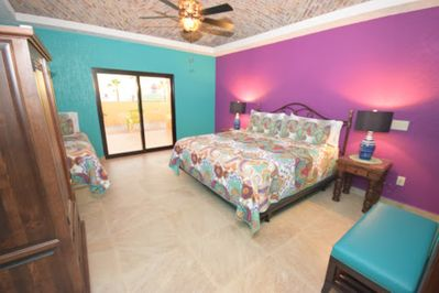 PURPLE ROOM WITH KING BED AND TWIN BED.