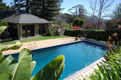 Solar heated pool with slide.
