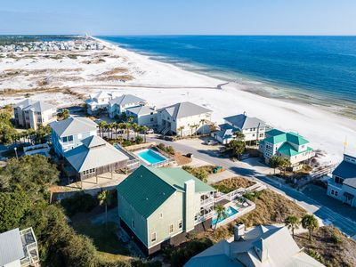 Photo for Gulf Views! Steps From The Beach! Private Heated Pool! Sprawling Porches!