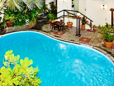 Photo for Homerez last minute deal - Nice studio with shared pool and Wifi