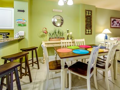Seating for 6 at the dinning table, with 3 bar stools at the kitchen counter.